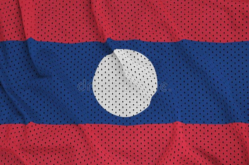 Den Laos flaggan skrivev ut på wi för ett tyg för ingrepp för polyesternylonsportswear arkivfoton