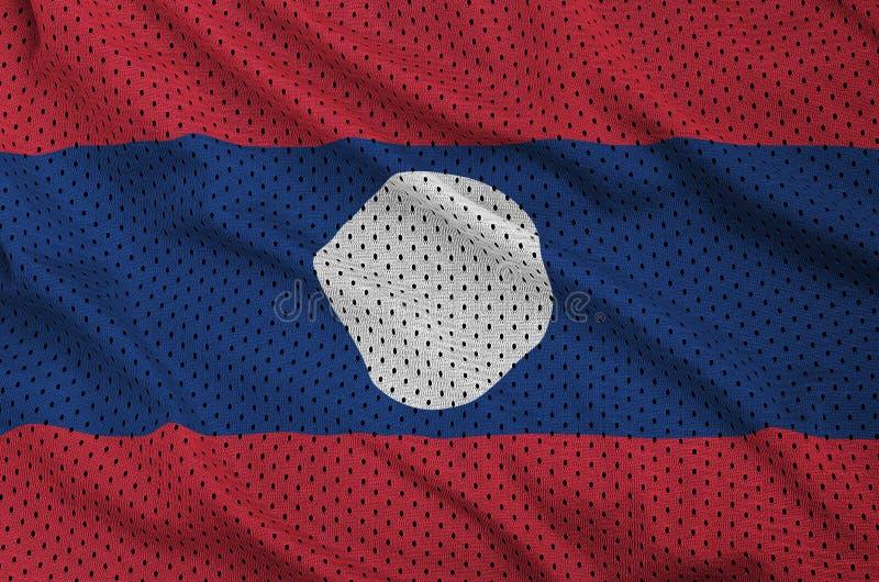 Den Laos flaggan skrivev ut på wi för ett tyg för ingrepp för polyesternylonsportswear fotografering för bildbyråer