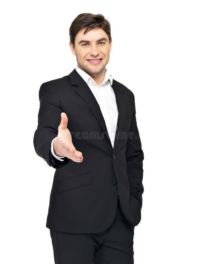 Den le affärsmannen i svart passar ger handskakningen royaltyfri fotografi