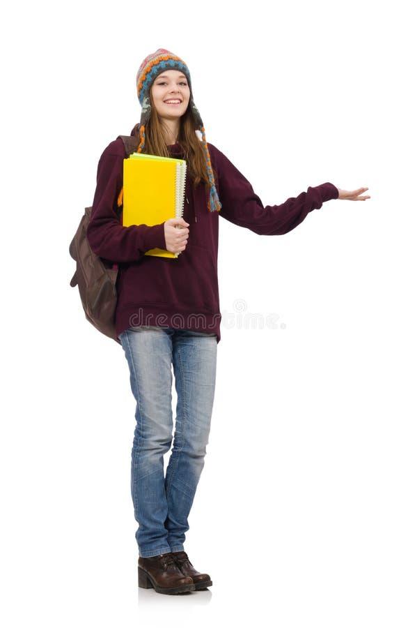 Den le studenten med ryggsäcken och boken som isoleras på vit arkivbild