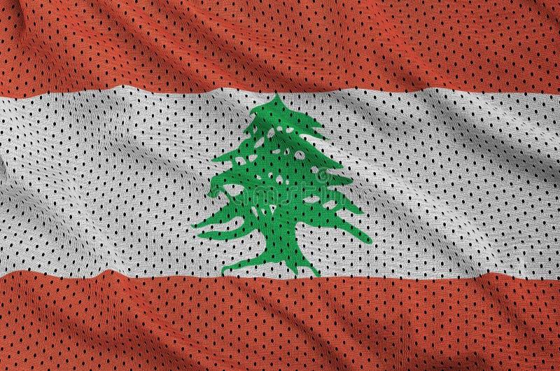 Den Libanon flaggan skrivev ut på ett tyg för ingrepp för polyesternylonsportswear royaltyfria foton