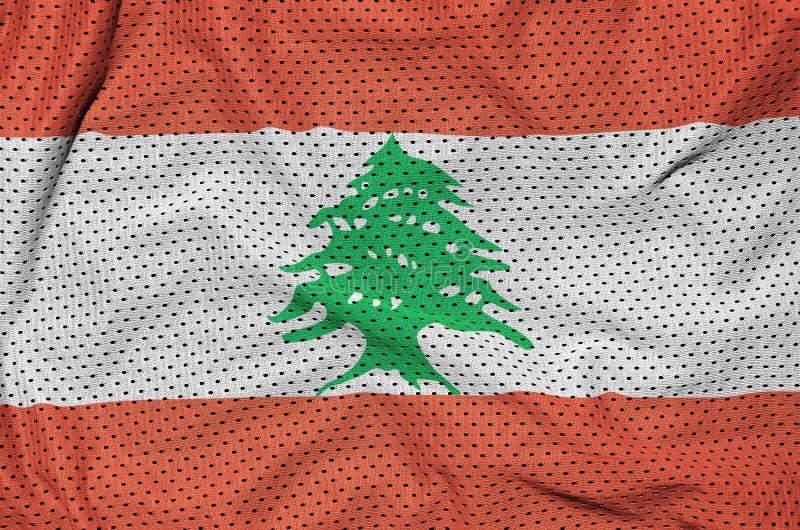 Den Libanon flaggan skrivev ut på ett tyg för ingrepp för polyesternylonsportswear arkivfoton
