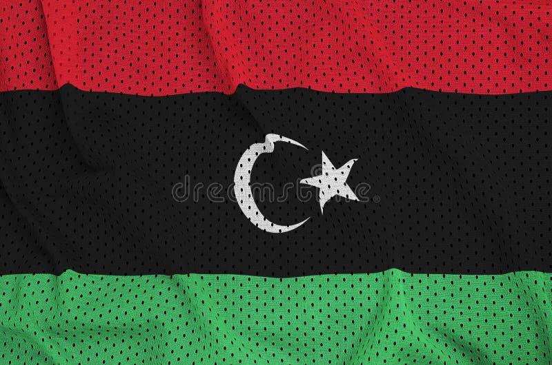 Den Libyen flaggan skrivev ut på ett tyg för ingrepp för polyesternylonsportswear w royaltyfria bilder