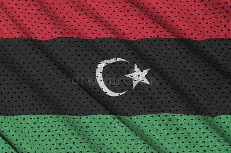 Den Libyen flaggan skrivev ut på ett tyg för ingrepp för polyesternylonsportswear w royaltyfri foto