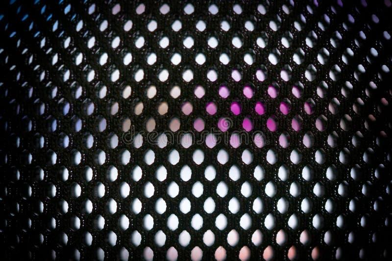 Den ljusa kulöra LEDDE videopd väggen med höjdpunkt genomdränkte modellen - nära övre bakgrund med grunt djup av fältet royaltyfri fotografi