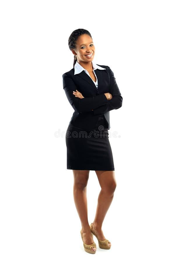 Den lyckade unga affärskvinnan med räcker vikt arkivbild