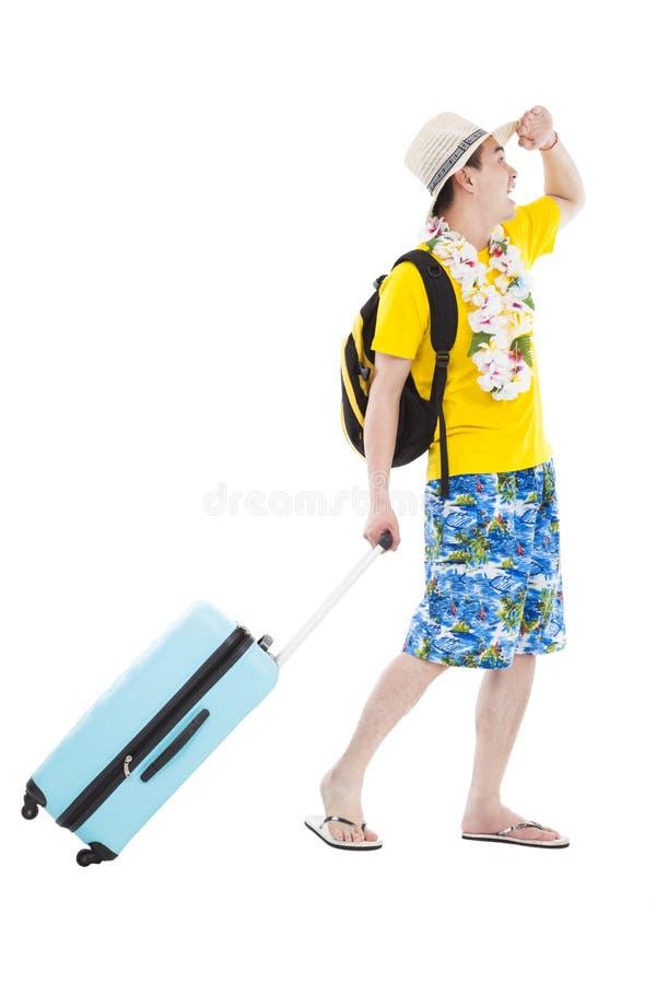 Den lyckliga manen tycker om sommarsemester och semestrar royaltyfria bilder
