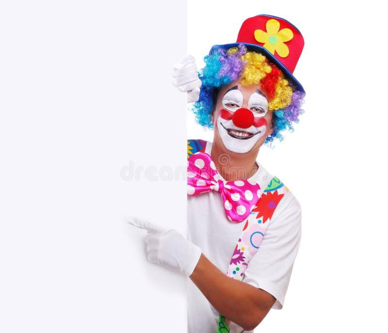 Den lyckliga clownvisningen tummar upp arkivbild