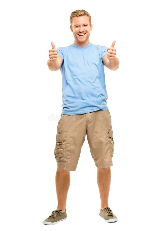 Den lyckliga mannen som ger tummar, up tecknet - full längdstående på vit royaltyfri fotografi