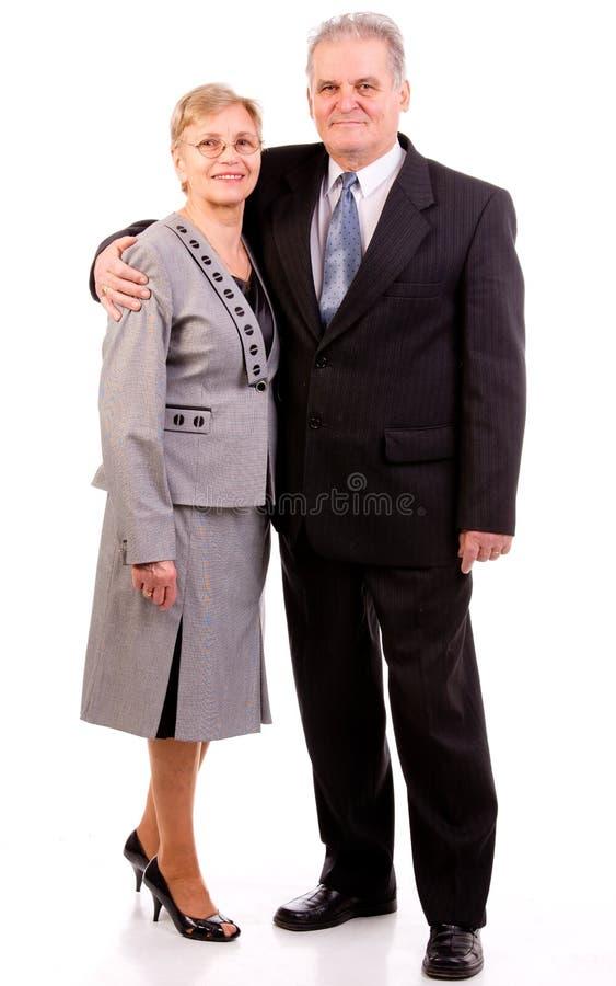 Den lyckliga pensionären kopplar ihop royaltyfri fotografi