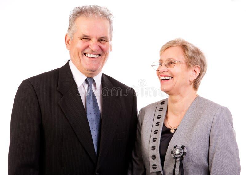 Den lyckliga pensionären kopplar ihop arkivbilder