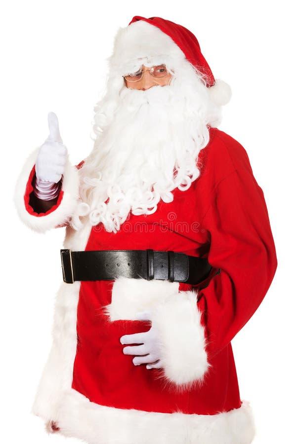 Den lyckliga Santa Claus visningen tummar upp royaltyfri bild