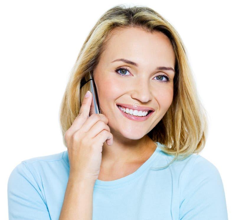 den lyckliga telefonen talar kvinnan arkivfoton