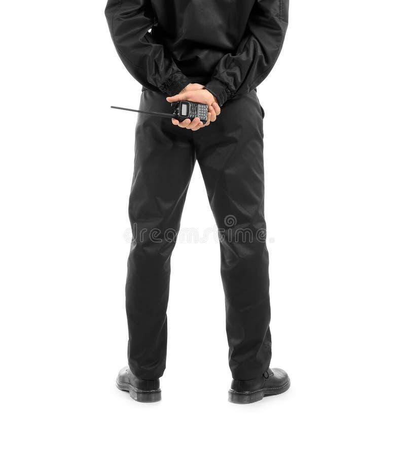 Den manliga ordningsvakten med bärbart radiosänder sändaren på vit bakgrund royaltyfria foton
