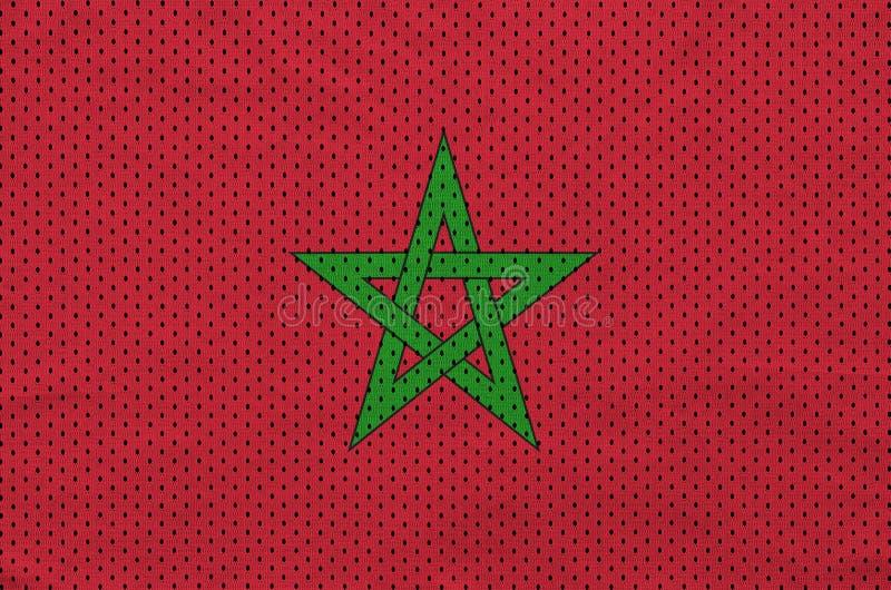 Den Marocko flaggan skrivev ut på ett tyg för ingrepp för polyesternylonsportswear arkivbilder