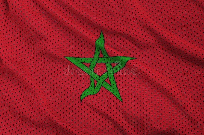 Den Marocko flaggan skrivev ut på ett tyg för ingrepp för polyesternylonsportswear royaltyfria bilder