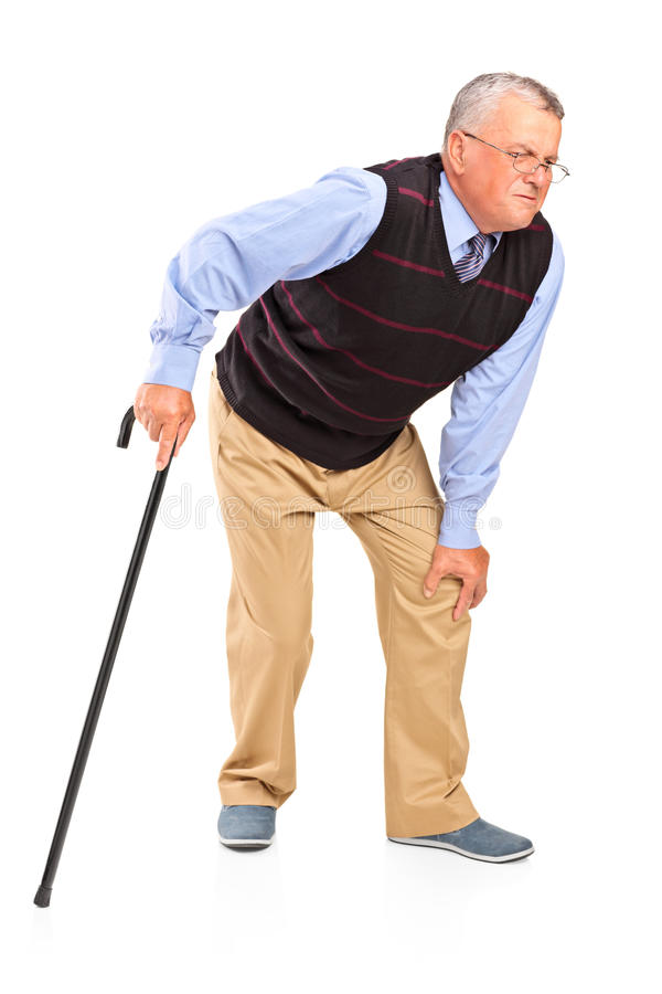 Den mogna mannen med ett knä smärtar royaltyfri fotografi