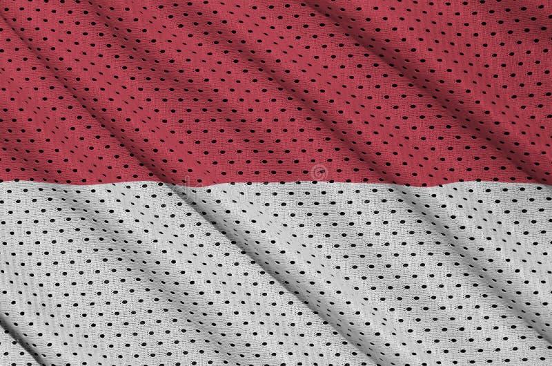 Den Monaco flaggan skrivev ut på ett tyg för ingrepp för polyesternylonsportswear arkivfoto