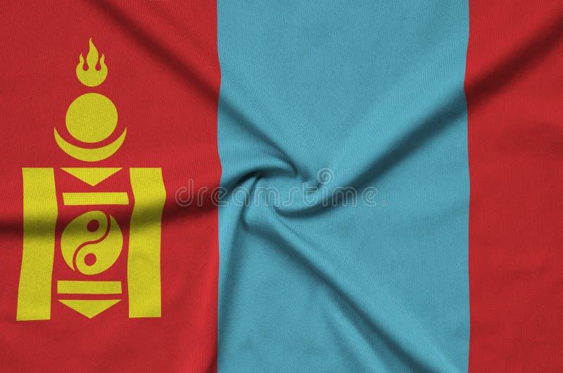 Den Mongoliet flaggan visas på ett sporttorkduketyg med många veck Baner för sportlag royaltyfri bild