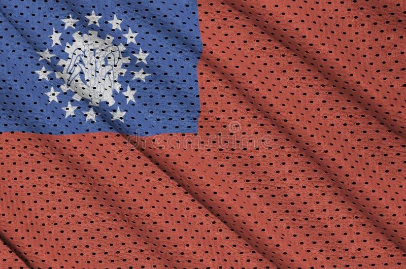 Den Myanmar flaggan skrivev ut på ett tyg för ingrepp för polyesternylonsportswear royaltyfri fotografi