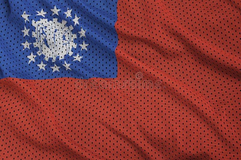 Den Myanmar flaggan skrivev ut på ett tyg för ingrepp för polyesternylonsportswear arkivfoto
