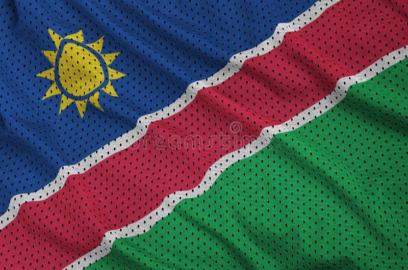 Den Namibia flaggan skrivev ut på ett tyg för ingrepp för polyesternylonsportswear arkivbild