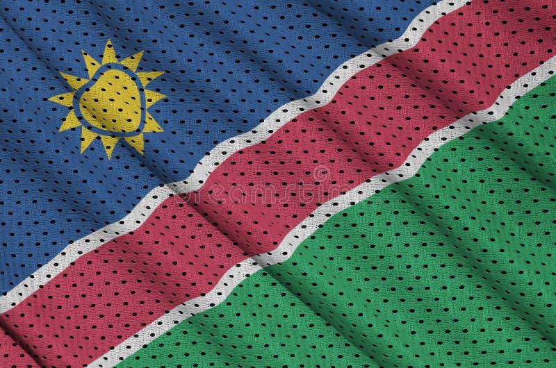 Den Namibia flaggan skrivev ut på ett tyg för ingrepp för polyesternylonsportswear fotografering för bildbyråer