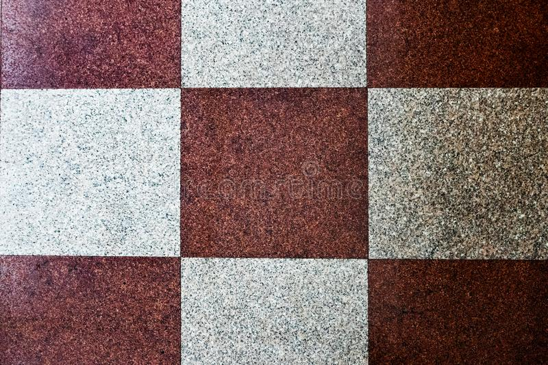 Den naturliga stenen som är slät marmorerar golvet, den abstrakta tegelplattan för bakgrundstexturer royaltyfri fotografi
