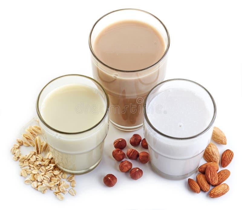 Den olika strikt vegetarian mjölkar arkivfoton