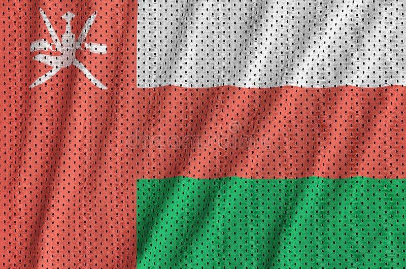 Den Oman flaggan skrivev ut på wi för ett tyg för ingrepp för polyesternylonsportswear fotografering för bildbyråer