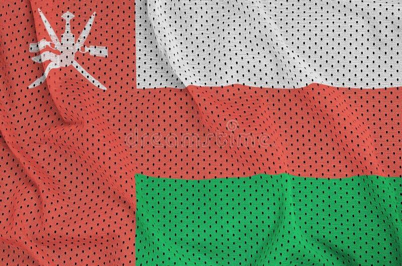 Den Oman flaggan skrivev ut på wi för ett tyg för ingrepp för polyesternylonsportswear arkivbild