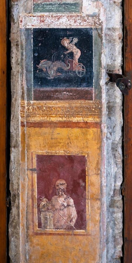 Den påskyndade amorinoen leder endragen triumfvagn i Pompeii royaltyfri bild