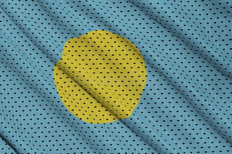 Den palauiska flaggan skrivev ut på ett tyg för ingrepp för polyesternylonsportswear w royaltyfria bilder