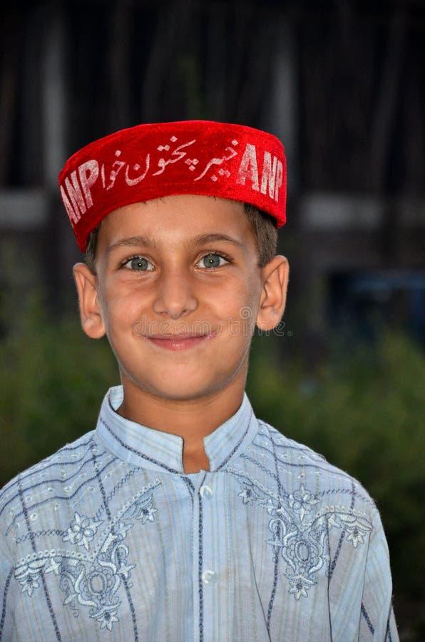 Den Pathan pojken på politiskt samlar Pakistan royaltyfri foto