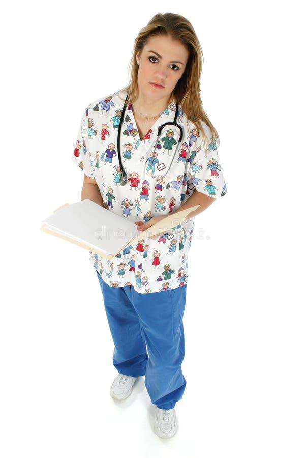 den pediatriska sjuksköterskan skurar royaltyfria foton