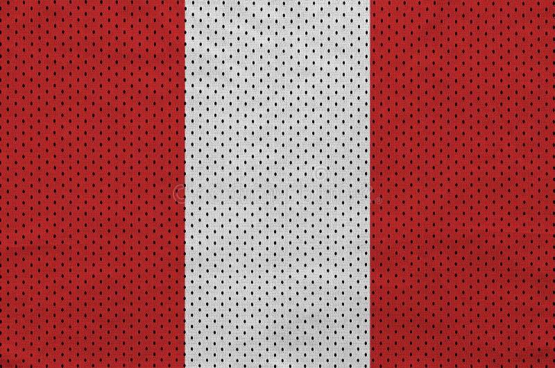 Den Peru flaggan skrivev ut på wi för ett tyg för ingrepp för polyesternylonsportswear royaltyfri foto