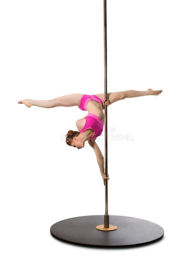 Den Pole danskonstnären gör för att tvinna på pylonen, utklipp royaltyfria bilder
