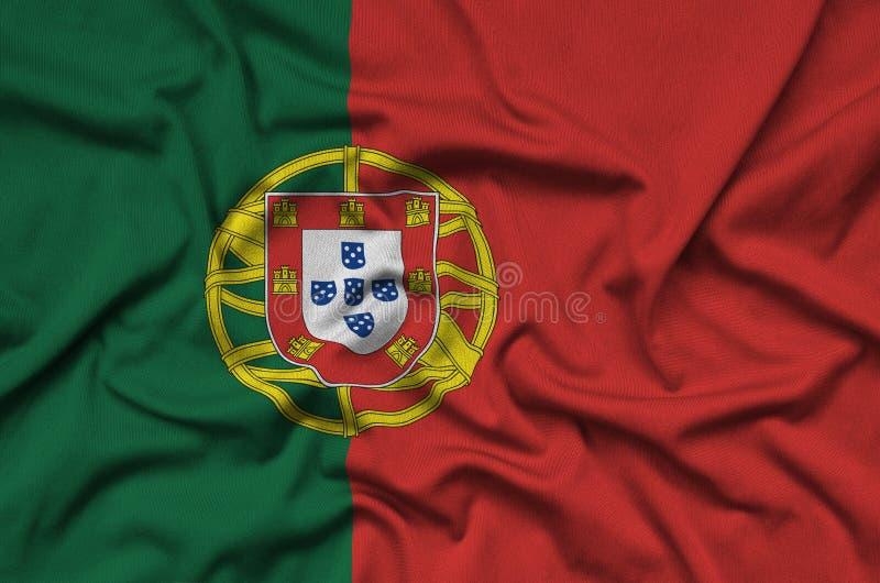 Den Portugal flaggan visas på ett sporttorkduketyg med många veck Baner för sportlag royaltyfri bild