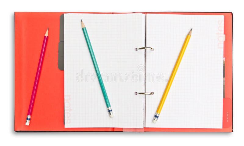Den röda anteckningsboken och ritar isolerat royaltyfria bilder