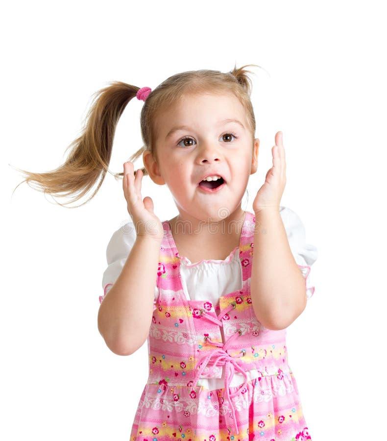 Den roliga barnflickan med händer vänder mot nästan isolerat på vit bakgrund royaltyfri foto