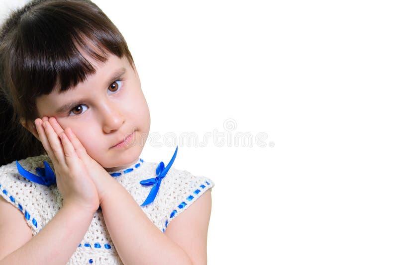 Den roliga barnflickan med händer vänder mot nästan isolerat på vit bakgrund royaltyfria foton