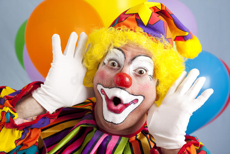 den roliga clownframsidan gör royaltyfria bilder