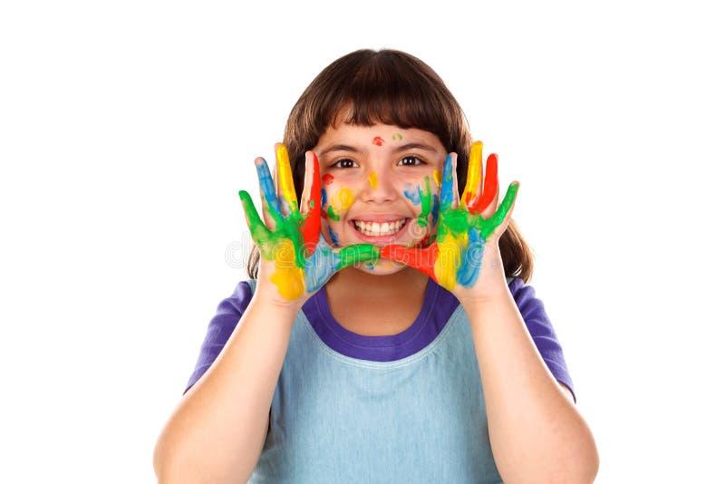 Den roliga flickan med hennes händer smutsar ner av målarfärg fotografering för bildbyråer