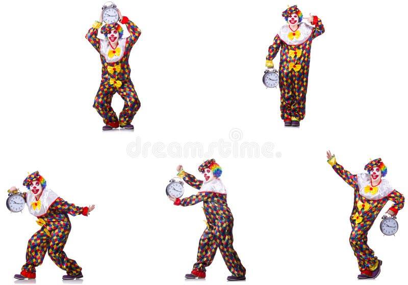 Den roliga manliga clownen med väckarklockan arkivfoto