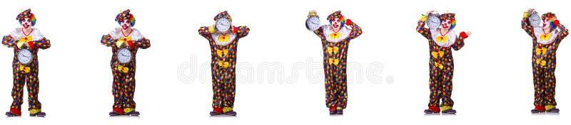 Den roliga manliga clownen med väckarklockan royaltyfri foto
