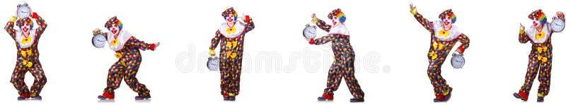 Den roliga manliga clownen med väckarklockan royaltyfria foton