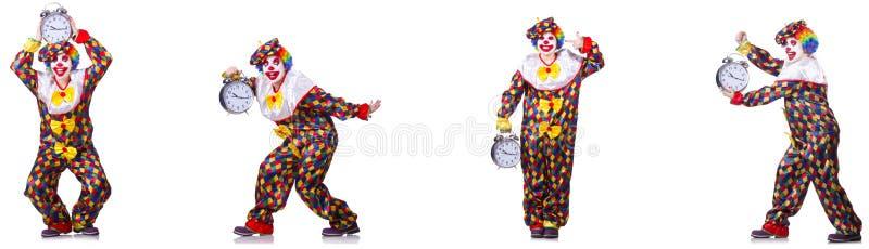 Den roliga manliga clownen med v?ckarklockan royaltyfri bild