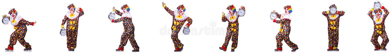 Den roliga manliga clownen med v?ckarklockan royaltyfri foto