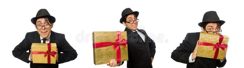 Den roliga mannen med giftbox på vit royaltyfri foto