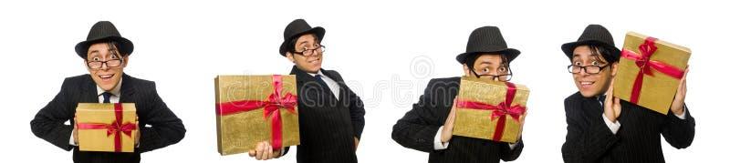 Den roliga mannen med giftbox på vit royaltyfri fotografi